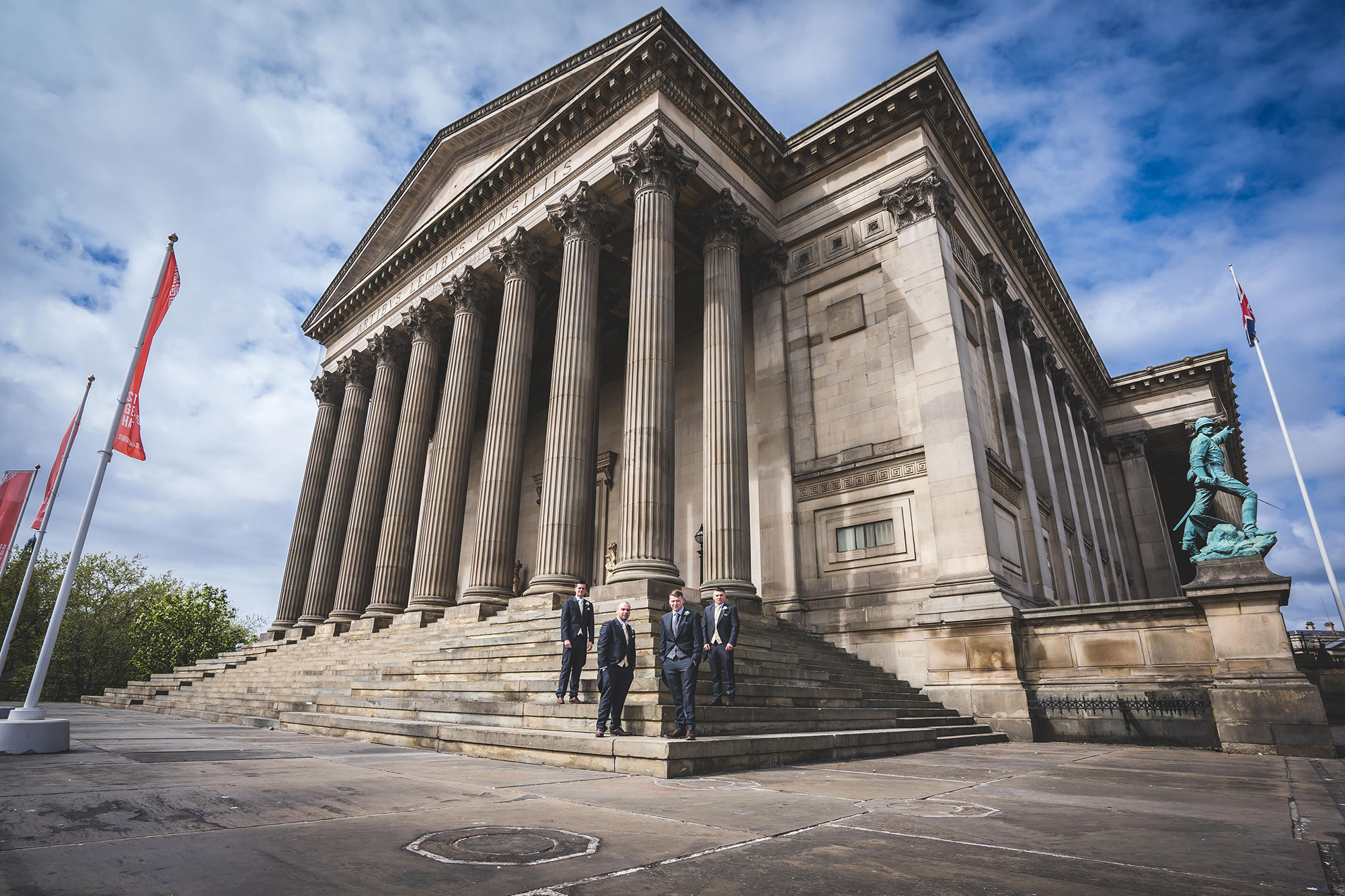 Groom and male guests outside St Georges Hall