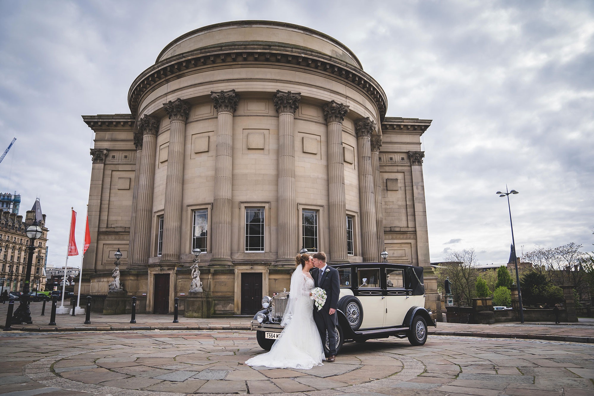 Married couple outside entrance to St Georges Hall